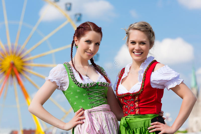 Women in traditional Bavarian clothes or dirndl on festival stock photo