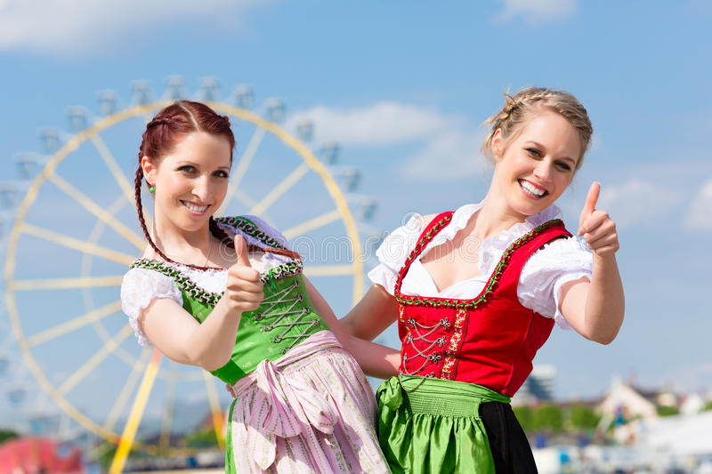Women in traditional Bavarian clothes on festival. Young women in traditional Bavarian clothes - dirndl or tracht - on a festival or Oktoberfest royalty free stock images