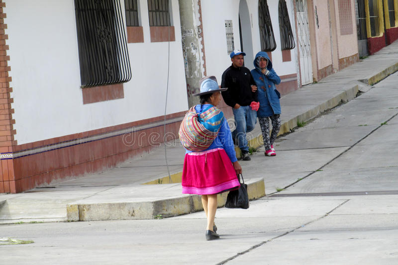 Women in traditional peruvian clothes and hats on the streets of Cuzco city royalty free stock photo