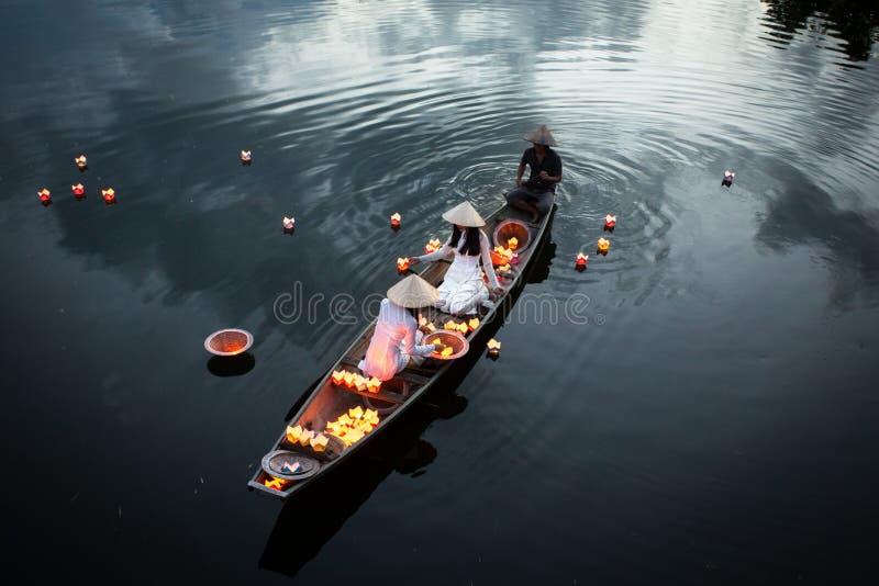 River lanterns with traditional Vietnamese dress, Vietnam stock photo