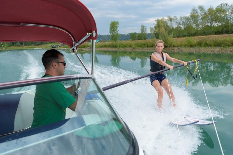 Woman training for water ski stock image