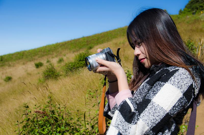 Women traveller take a photo with digital camera stock images