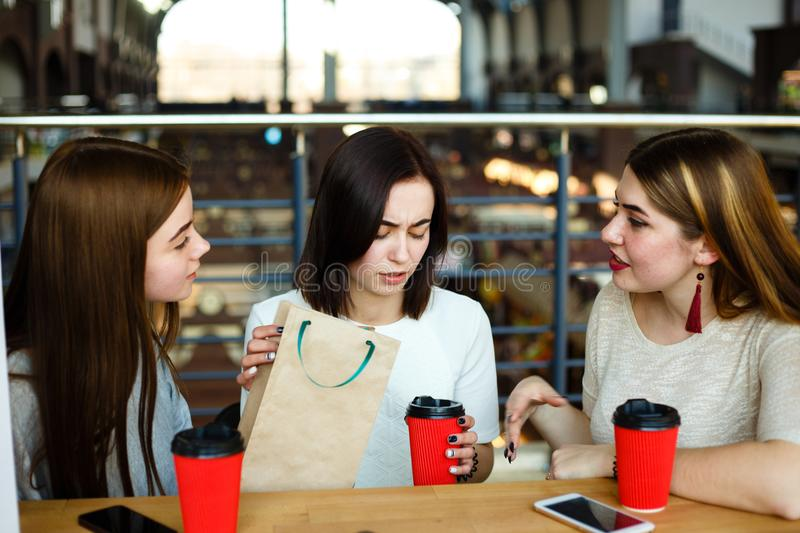Women trying to cheer up their depressed friend stock photography