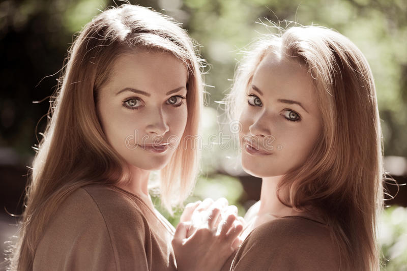 Women, twins in the forest. Two women, twins in the forest