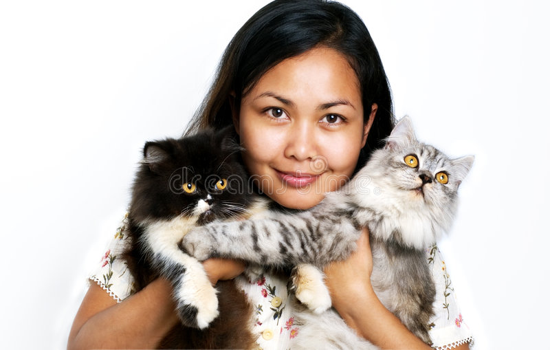 Women with two cats stock image