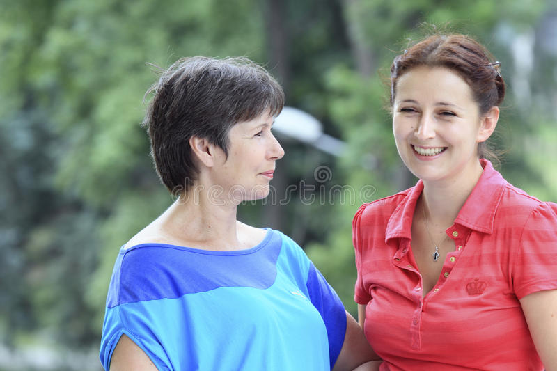 Women of two generations stock image