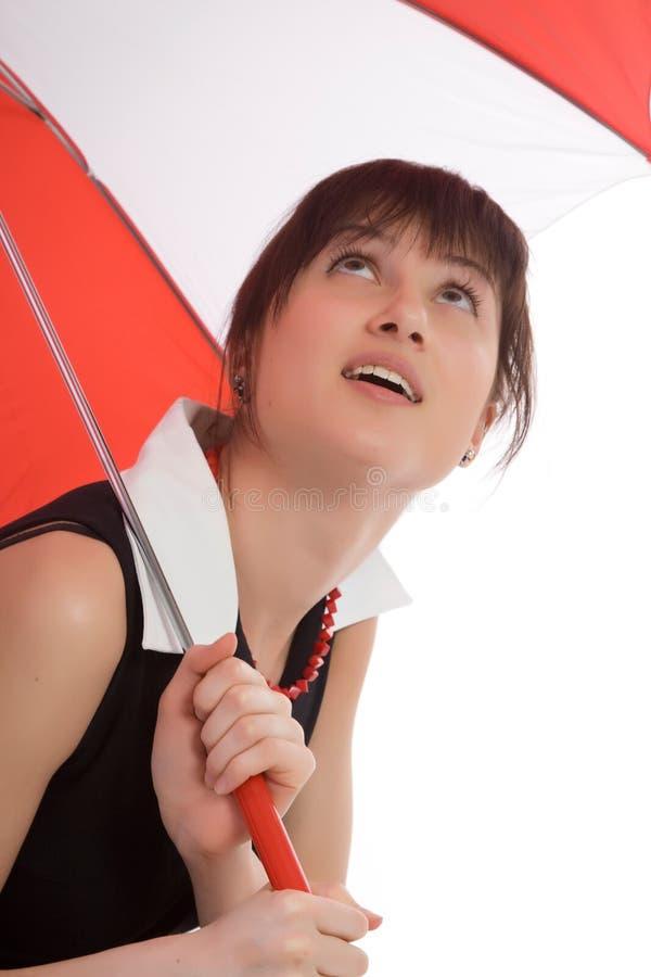 The women under an umbrella looks upwards. royalty free stock photography