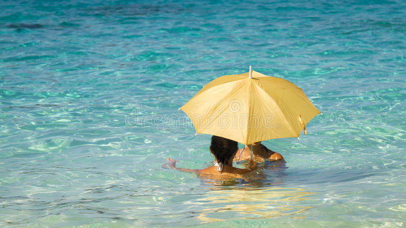 Women under an umbrella 1 royalty free stock photo