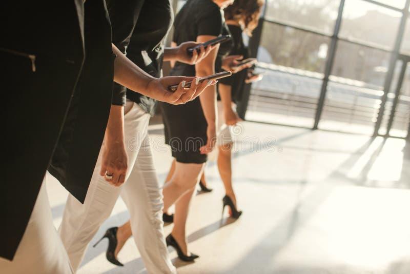 Women unity partnership business phone concept stock images