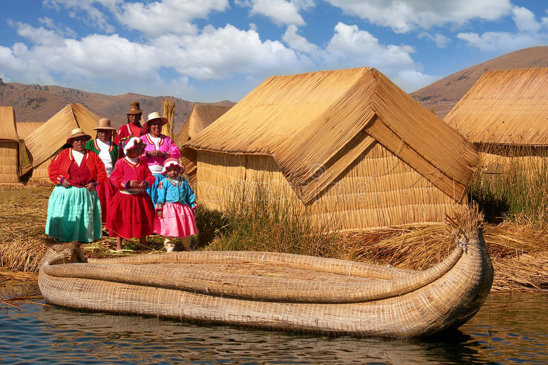 Women Uros Reed Huts Lake Titicaca Floating Island royalty free stock photography