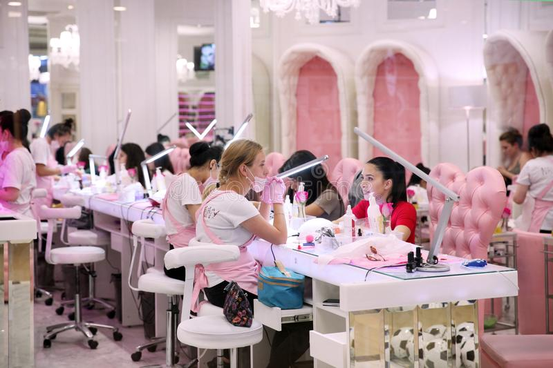 Women use the Express manicure service in the salon of the shopp. Ing centre. Moscow royalty free stock photography