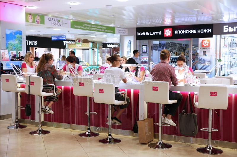 Women use the Express manicure service at the shopping centre . Moscow royalty free stock image