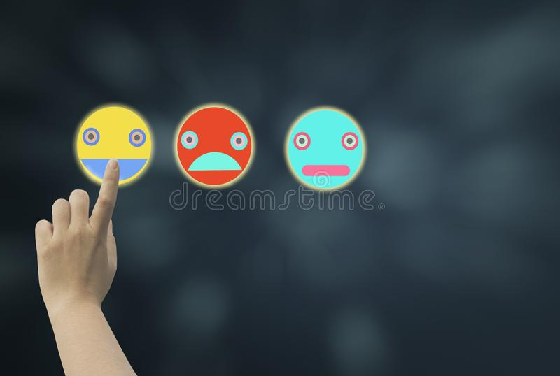Women use finger touch left side screen icon emoji showing various emotions and feeling on dark blue bokeh background,concept to royalty free stock image