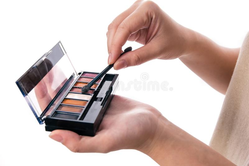 Women using cosmetic brush royalty free stock photos