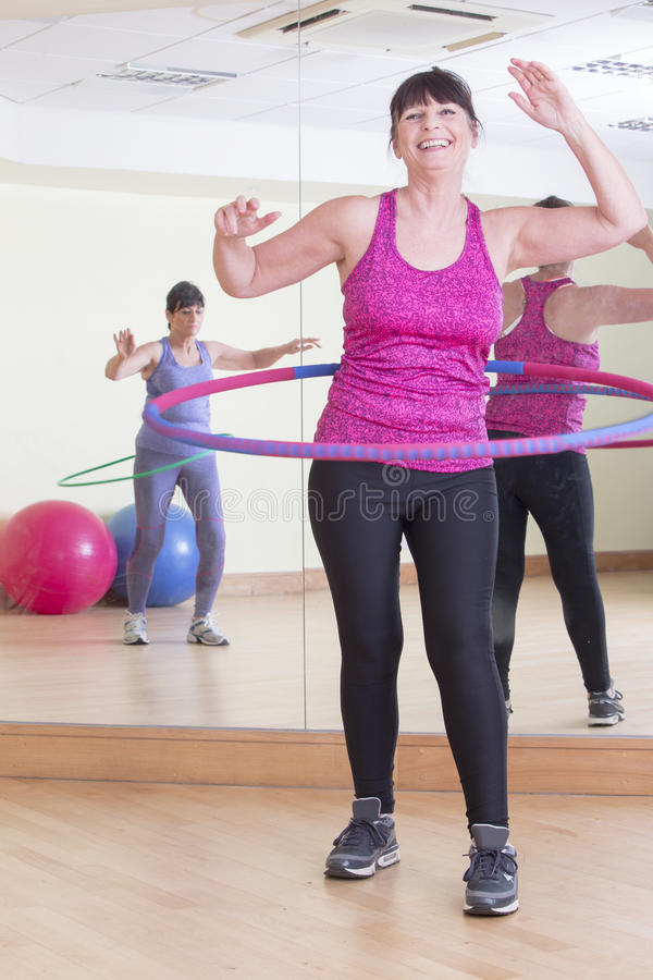 Women using hoops at the gym royalty free stock photography