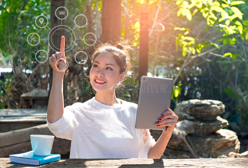 Women using laptop payments online shopping and icon customer network connection on screen. In the nature park royalty free stock photos