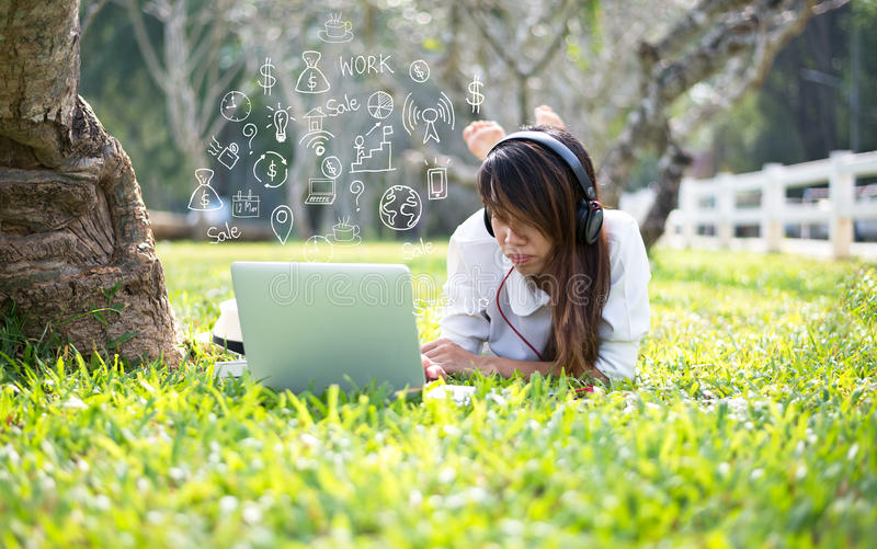 Women using mobile payments online shopping and icon customer network connection. On screen, in the nature park stock photography