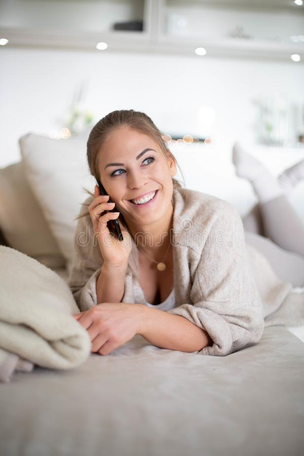 Women is using a mobile phone royalty free stock images