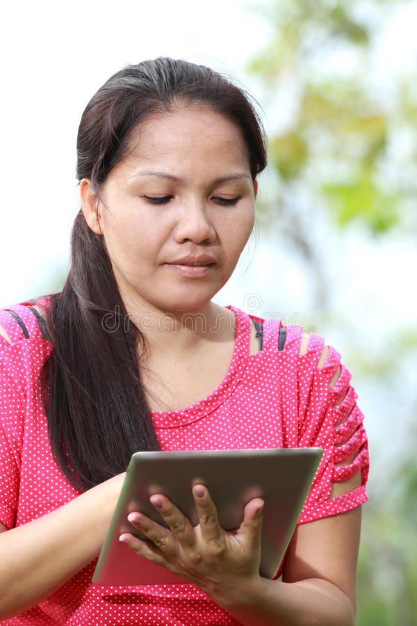 Download Women using tablet stock photo. Image of computer, hair - 25950640