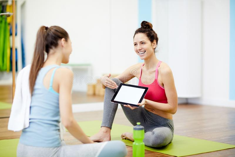 Women Using Tablet in Fitness Club stock photography