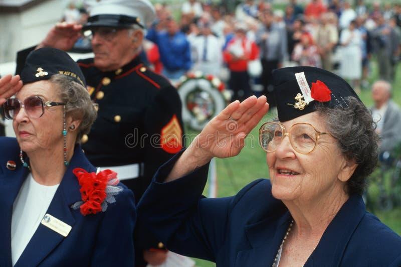 Women Veterans saluting. World War II Women Veterans saluting at ceremony at Veteran's National Cemetery, Los Angeles, California royalty free stock photos