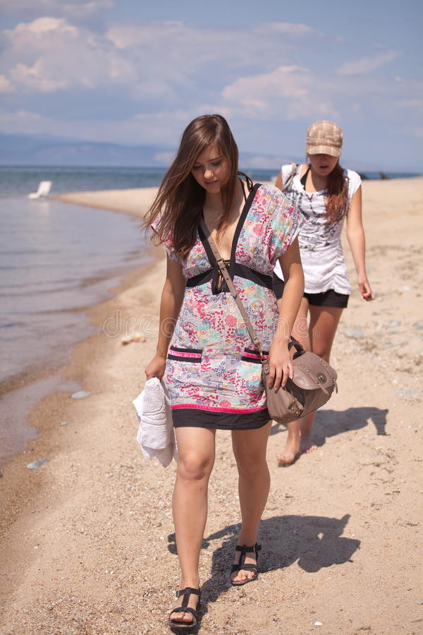 Women walking on beach stock image. Image of young, sunny ...