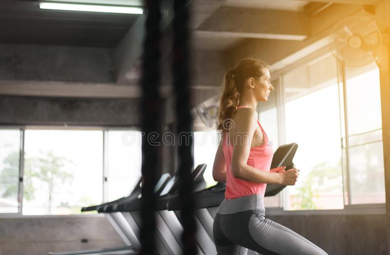 Woman walking and running cardio training in a gym,Healthy lifestyle concept stock photography