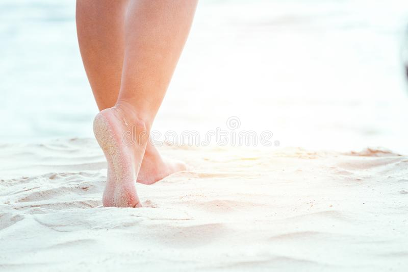 Women walking on the beach. royalty free stock images