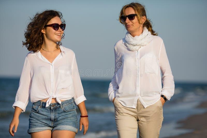 Women walking on the seaside stock photo
