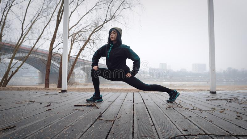 Women is warming-up before running/jogging. Woman is exercising royalty free stock image