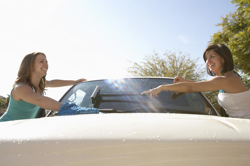 Women Washing Car Together stock photo