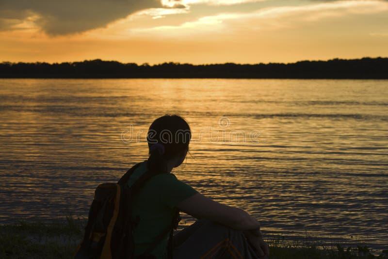 Women watching sunset stock photography