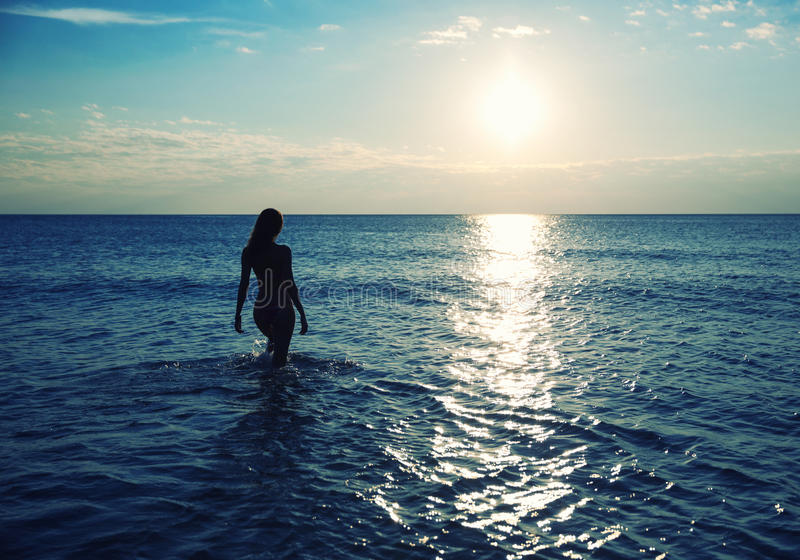 Download Women in water at sunset stock image. Image of life, pier - 38960375