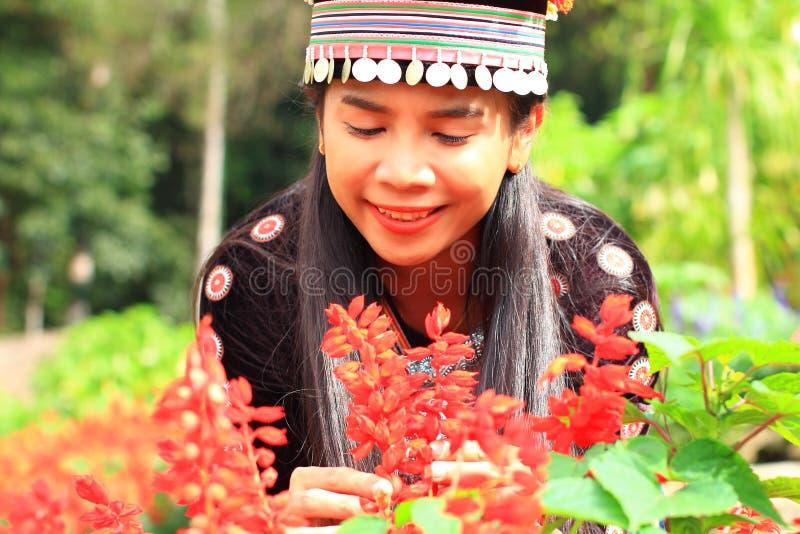 Women wear hill tribe costume. In flower garden royalty free stock photography