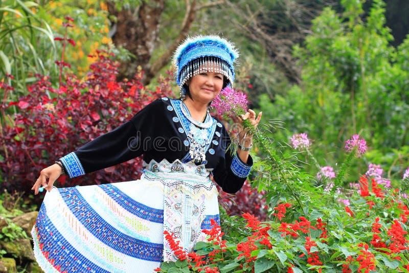 Women wear hill tribe costume. In flower garden stock photography