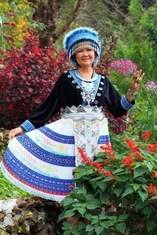 Women wear hill tribe costume. In flower garden royalty free stock photos