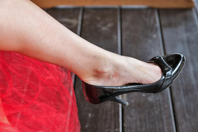 Women wearing high heels single leg closeup royalty free stock image