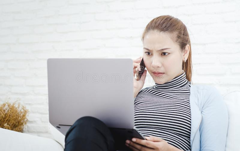 Women wearing blue shirts She is working And stressful conditions royalty free stock photography