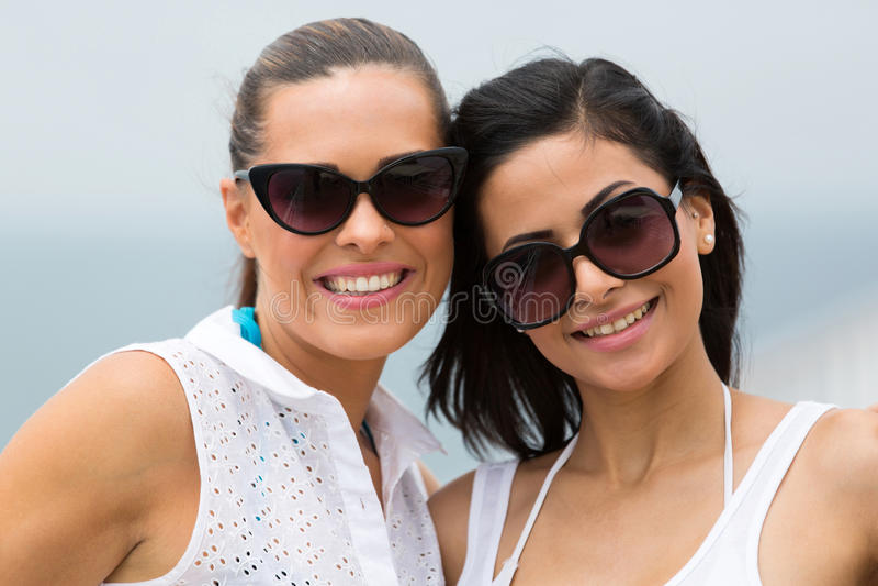 Women wearing sunglasses royalty free stock photography