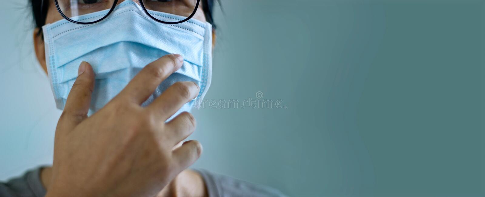 Women wearing virus mask protect of infection and spreading Coronavirus or Covid-19 on green background stock photography