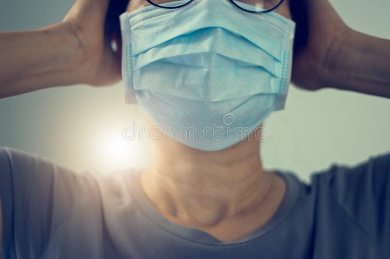 Women wearing virus mask protect of infection and spreading Coronavirus or Covid-19 on hospital background royalty free stock images
