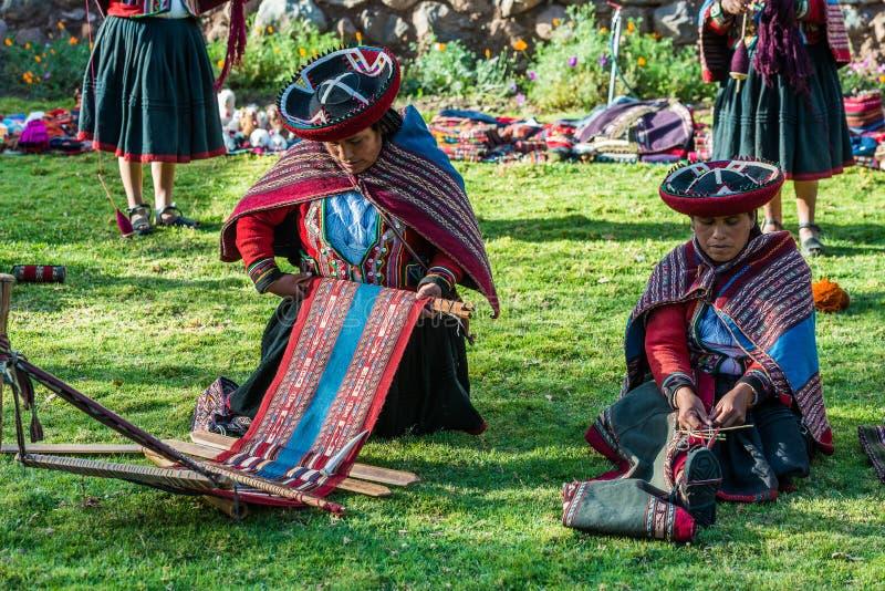 Women weaving peruvian Andes Cuzco Peru. Cuzco, Peru - July 15, 2013: women weaving in the peruvian Andes at Cuzco Peru on july 15th, 2013 stock photos