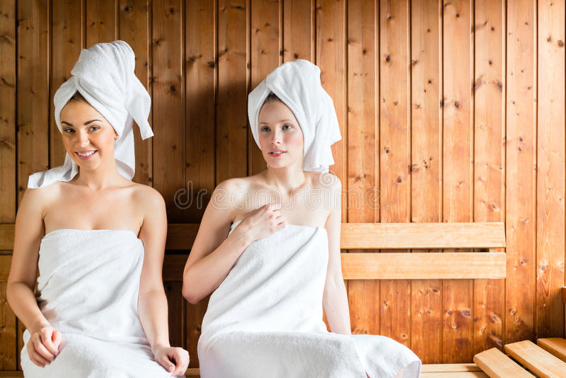 Women in wellness spa enjoying sauna infusion royalty free stock image