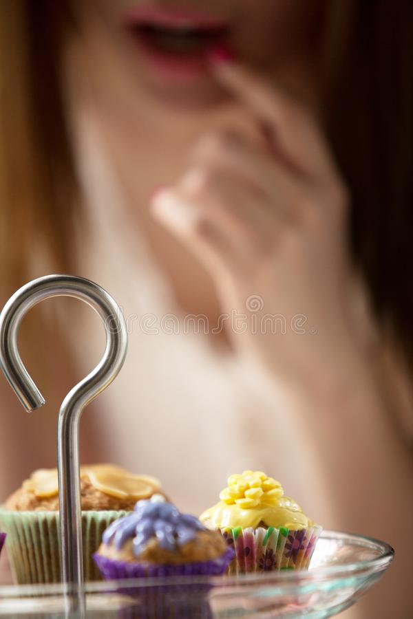 Women are picking cakes from the plate stock photography