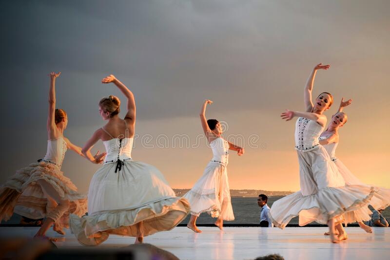 5 Women in White Dress Dancing Under Gray Sky during Sunset royalty free stock photo