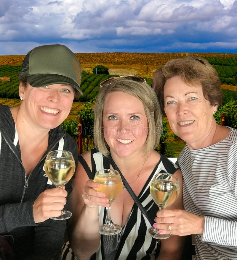 Women Wine tasting at Vineyard Eastern Washington. Yakima Valley wineries offer views of the vineyards and wine tasting. Storm clouds gather on hot afternoon at stock photos