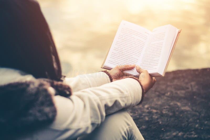 Women in winter sit read favorite book. Women in winter sit read favorite book in the holiday royalty free stock photo