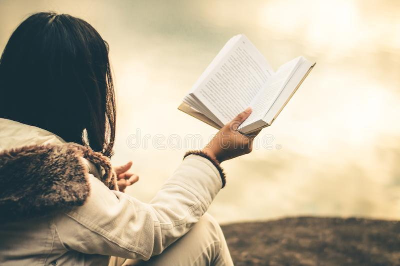 Women in winter sit read favorite book in the holiday. royalty free stock photo