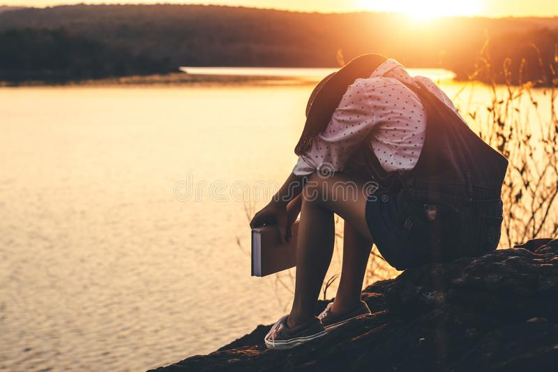 Women in winter sit read favorite book in the holiday, Concept girl reading a book.  royalty free stock photo
