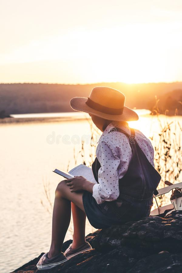 Women in winter sit read favorite book in the holiday, Concept girl reading a book.  stock images